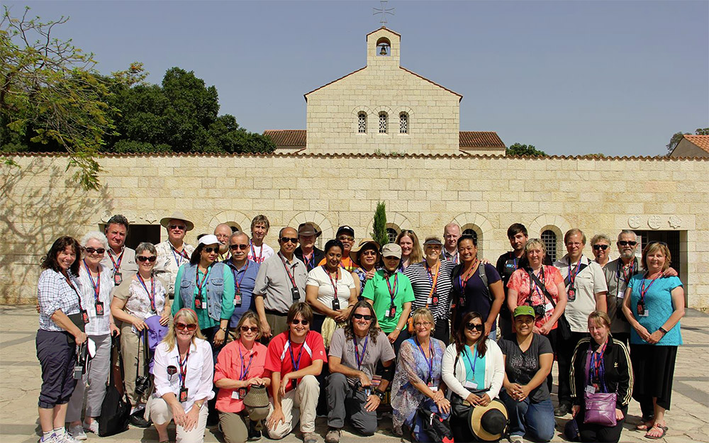 A church group visiting an ancient site In Israel