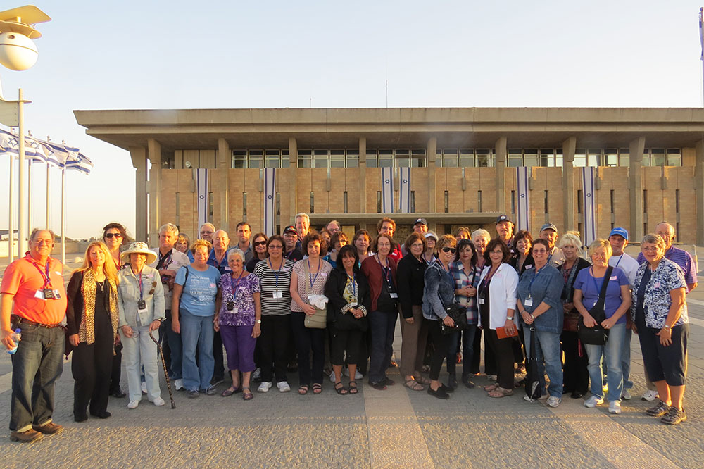 A Jewish tour taking a photo in front of the Knesset