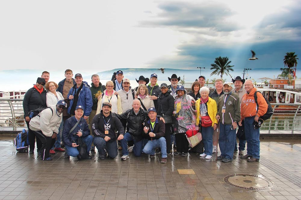 A beautiful photo of a Christian group and happy travelers