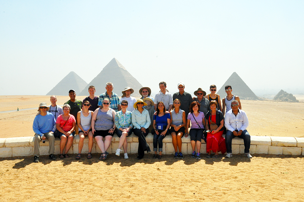 An Into the Promised Land tour in front of the pyramids