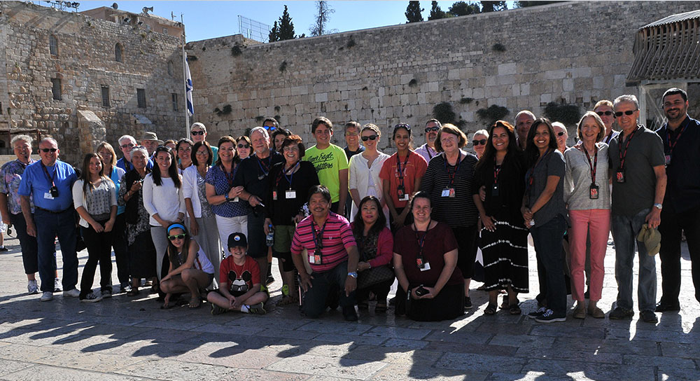 A Jewish tour in front of the Western Wall in Israel